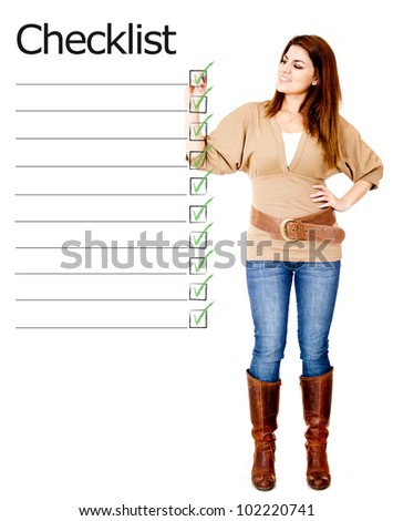 Woman ticking on a checklist - isolated over a white background - stock photo
