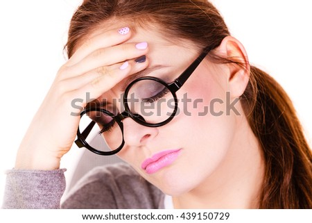Woman tired businesswoman overworked young female suffering from head pain isolated on white. Headache, migraine and stress - stock photo