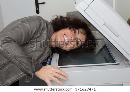 Woman tired to wait until printer print document, isolated on white - stock photo