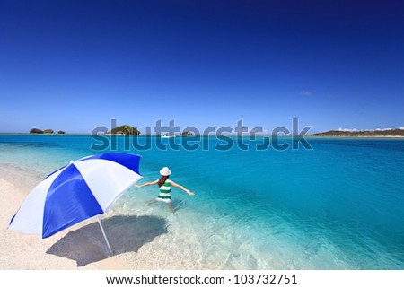 Woman to swim in a sea of cobalt blue - stock photo