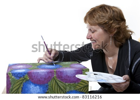 Woman tole painting a wooden box - stock photo