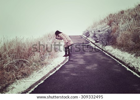 Woman touch on frozen leave in vintage style - stock photo
