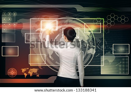 woman touch shining virtual button in  blue red and yellow web interface - stock photo