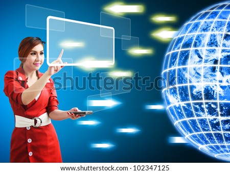 Woman touch windows icon from digital world : Elements of this image furnished by NASA - stock photo