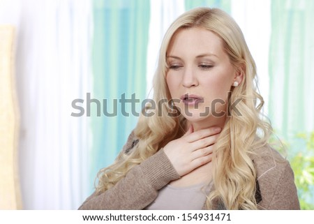 woman touches her throat - stock photo