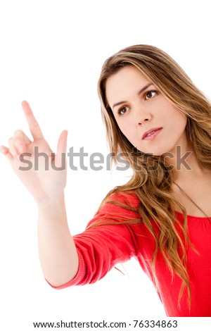 Woman touching an imaginary screen with her finger - isolated - stock photo