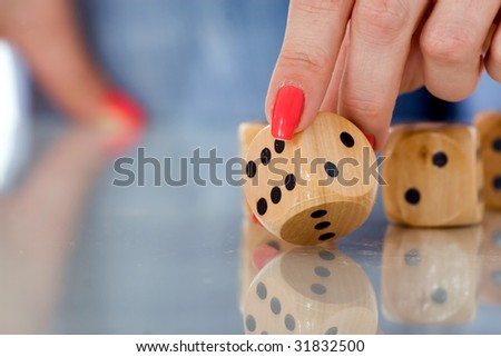 woman touching dice with her fingers 1
