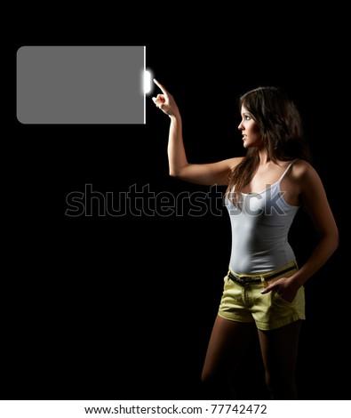 Woman touching digital screen display - stock photo