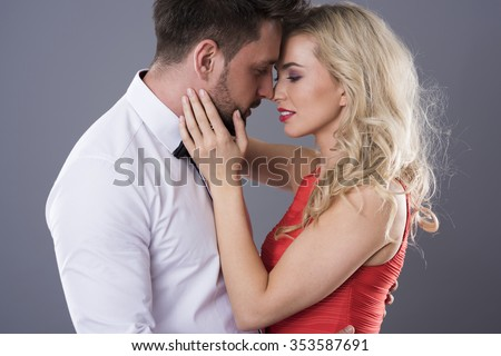 Woman touching face of handsome man