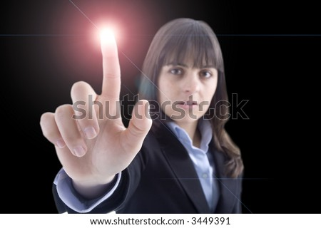 woman touching light button with her finger isolated on black background - stock photo