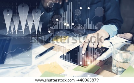 Woman Touching Screen Electronic Tablet Hand.Project Managers Researching Process.Business Team Working New Startup modern Office.Digital Connections world wide interfaces.Analyze market stock.Blurred - stock photo
