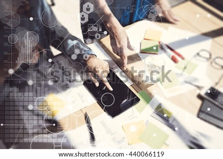 Woman Touching Screen Electronic Tablet Hand.Project Managers Researching Process.Business Team Working New Startup modern Office.Digital Charts world wide interfaces.Analyze markets stocks.Blurred - stock photo