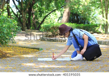 Woman tourist with map on vacation, travel concept