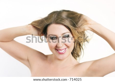 Woman tousling hair, smiling, fun, beauty, flirty, etc