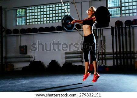 Woman training snatch at gym - stock photo