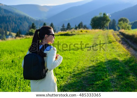woman travailing by meadow