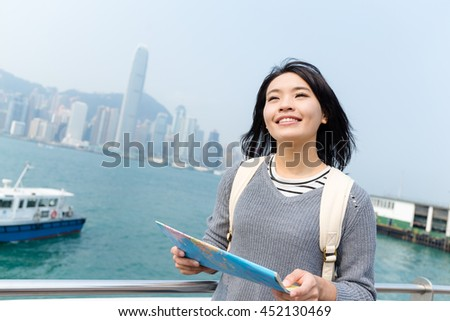 Woman travel in Hong Kong and using city map - stock photo