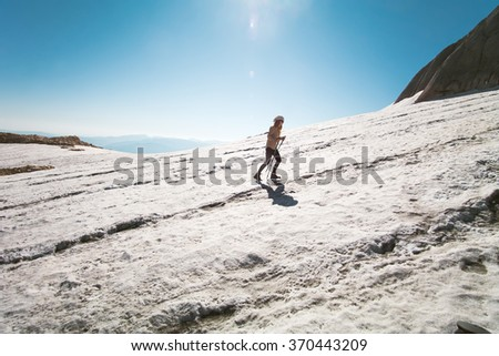Woman Traveler climbing Travel Lifestyle concept mountains glacier on background Summer vacations activity outdoor  - stock photo
