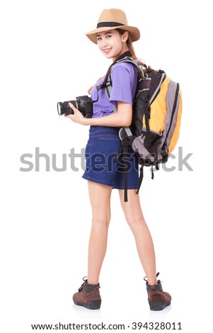Woman traveler with a camera on white background - stock photo