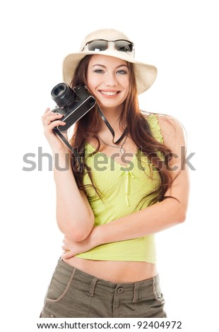 Woman traveler with a camera, white background - stock photo