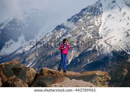 Woman traveler with backpack Hiking in mountains with beautiful landscape on background mountaineering sport lifestyle concept - stock photo