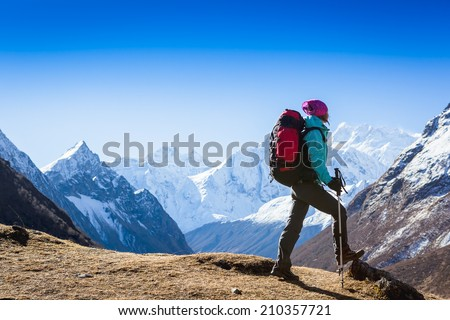 Woman Traveler with Backpack hiking in Mountains with beautiful summer landscape on background. mountaineering sport lifestyle concept  - stock photo