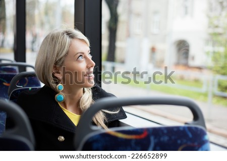 Woman traveling in public transport - stock photo