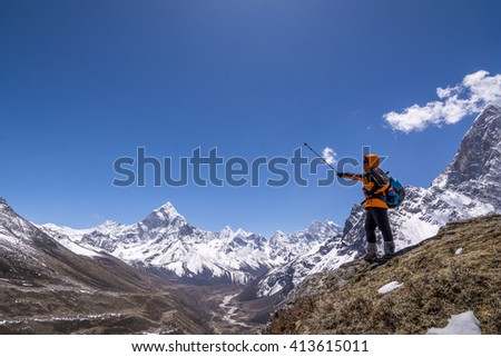 Woman trekker in the mountain during everest base trekking.