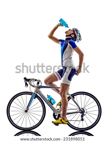 woman triathlon athlete  cyclist cycling drinking on white background - stock photo