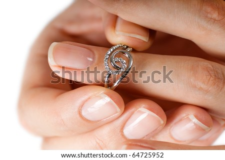 Woman tries on her beautiful ring. Macro photo. - stock photo