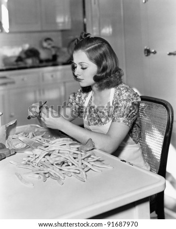 Woman trimming beans