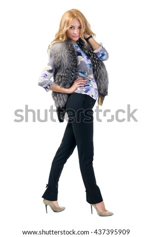 Woman trying jacket with fur. - stock photo