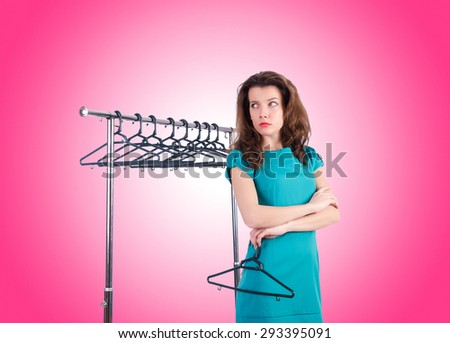 Woman trying new clothing against gradient  - stock photo