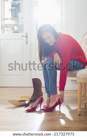 Woman trying on footwear in store - stock photo