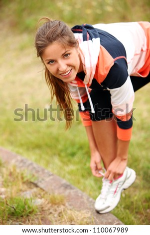 Woman trying running shoes - stock photo