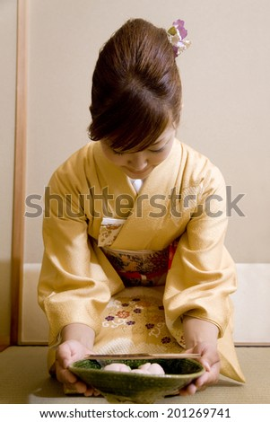Woman trying to eat sweets