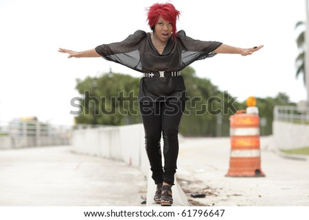 Woman trying to keep her balance - stock photo