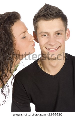 woman trying to kiss the man on white background - stock photo