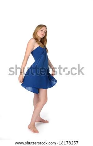 woman twirling in a blue dress - stock photo