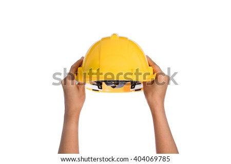 Woman two hand holding a hardhat, helmet isolated on white background - stock photo