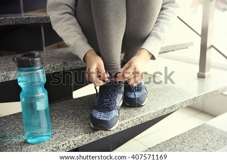 Woman tying up running shoe - stock photo