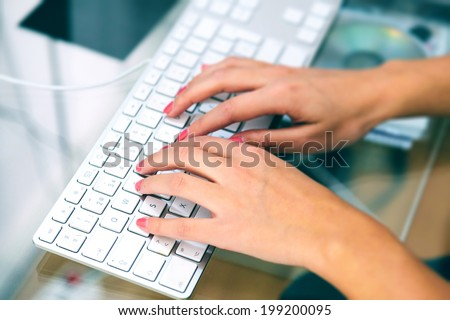 Woman Typing in her Laptop - stock photo