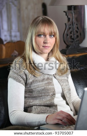 Woman typing on her laptop at home - stock photo
