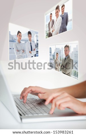 Woman typing on her laptop with digital interface on background