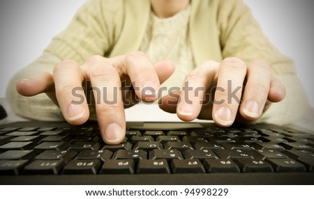 woman typing on keyboard in office - stock photo