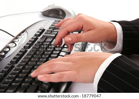 Woman typing on the computer keyboard - stock photo