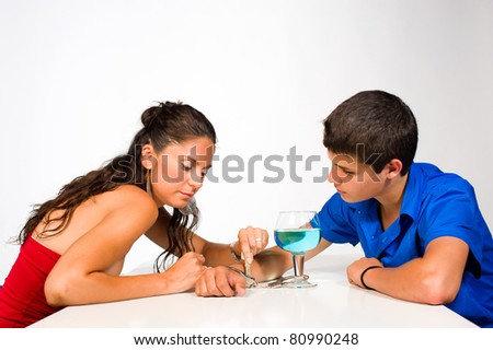 Woman unchaining a teenager from his alcohol addiction - stock photo