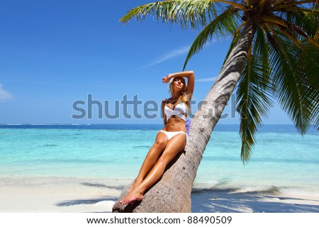 woman under palm sea on backgroud - stock photo