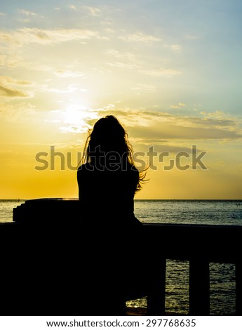 woman under the sunset at sea