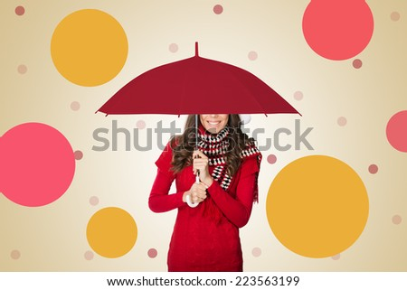 Woman under umbrella smiling - stock photo